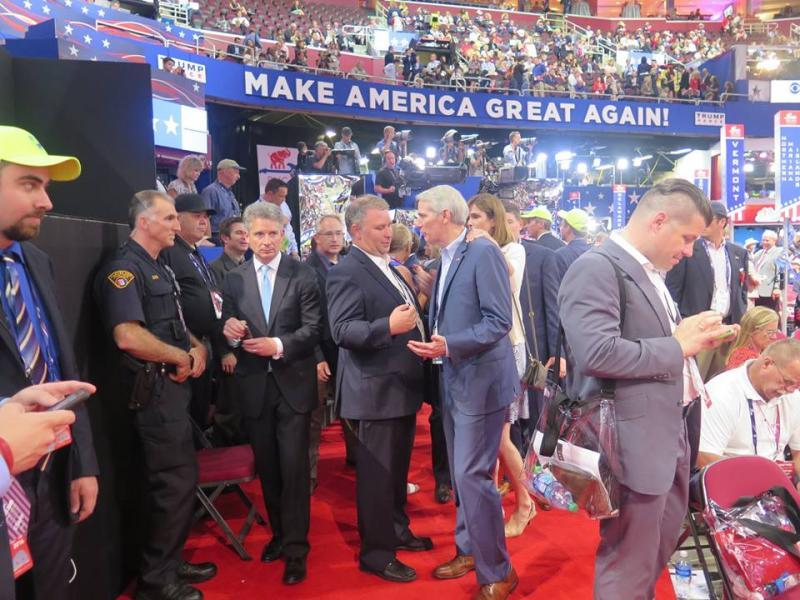 Ohio Republican Party Chair Matt Borges talks with U.S. Sen. Rob Portman (R-OH) on the convention floor at the RNC in Cleveland in July.