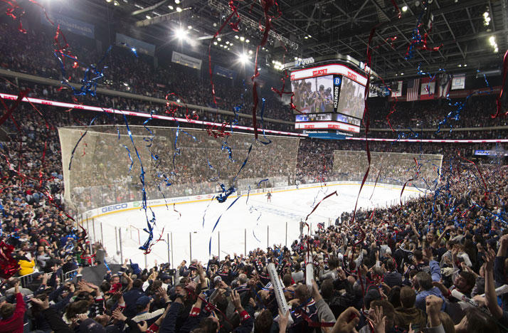 Fans celebrate a Columbus Blue Jackets win inside Nationwide Arena.