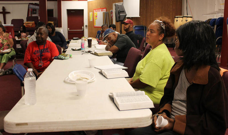 Participants in a Bible study at Crack House Ministries on addition.