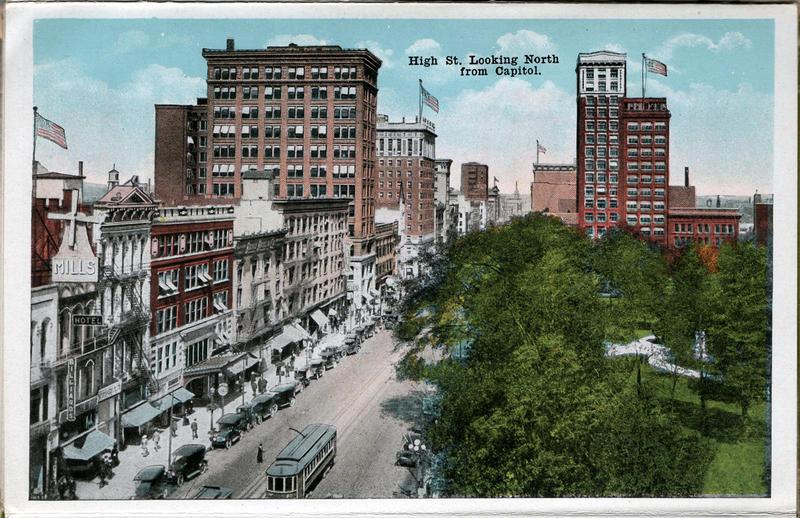 A 1915 postcard shows a streetcar going down High Street near the capitol.