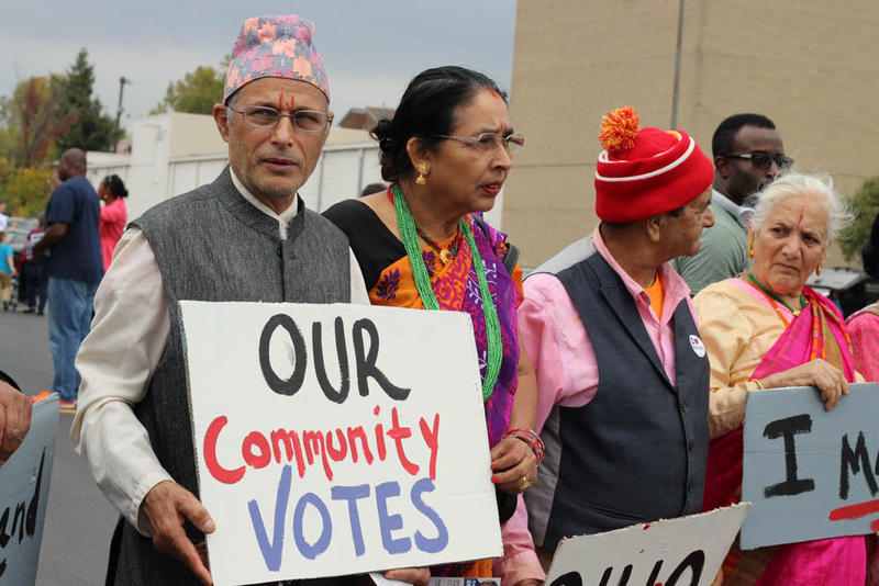 During early voting, Bhutanese refugees who spoke English shuttled other members of their community to the polls to help them vote.