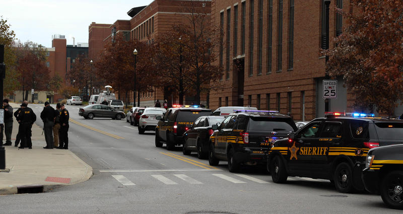 An attacker drove a car over a curb and struck pedestrians, before attacking people with a knife on Monday morning. The suspect was shot and killed by police.