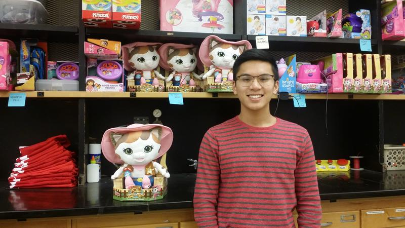 Jarrod Manguiat stands next to the shelves of toys that Ohio State students adapted for developmentally disabled kids.