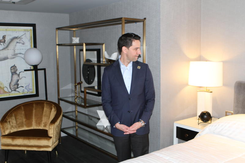 Michael Shannon, marketing manager for the LeVeque, stands in one of its hotel rooms.