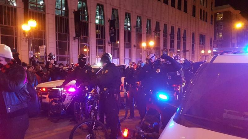 Protesters filled the street before police deployed pepper spray. No arrests were reported.