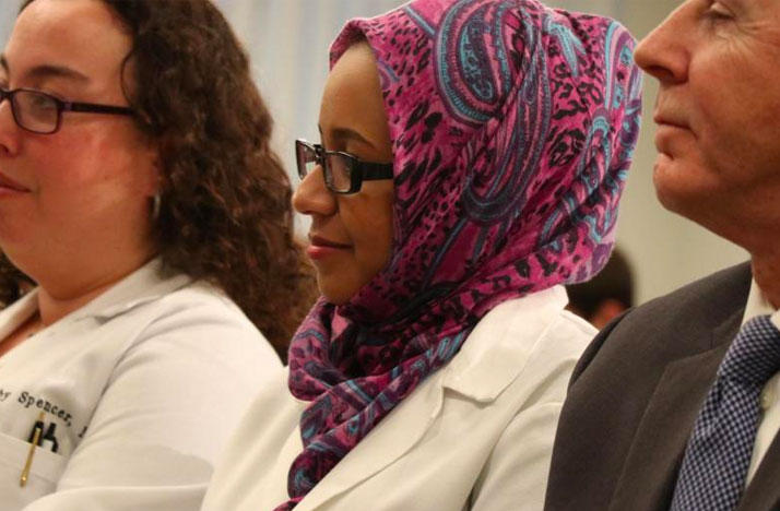Dr. Suha Abushamma (center) at a press conference on Tuesday discussing her return to the U.S.
