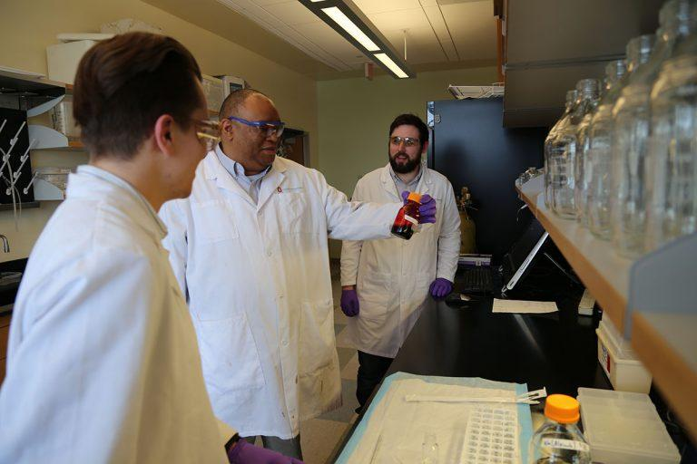 Dr. Andre Palmer (center) is working with other researchers on the hemoglobin-based material.