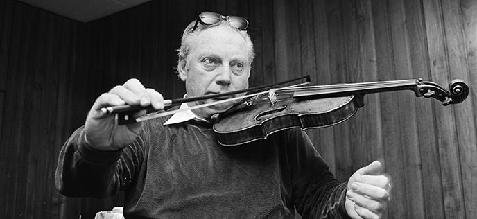 black-and-white photo of Isaac Stern playing a violin
