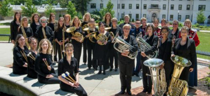 color photo of the members of Monarch Brass standing outdoors and holding their instruments