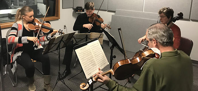color photo of the ProMusica String Quartet performing in the Classical 101 studios