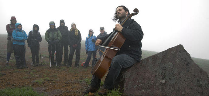 After completing the more-than-7-mile trek up a dormant volcano in Kruzof Island, Alaska, Bailey performed Bach on his fiber carbon cello.