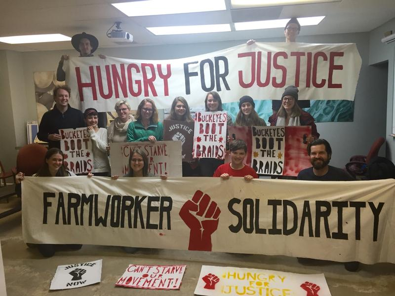 Members of the Student Farm Worker Alliance gather for a meal before the fast starts on Monday.