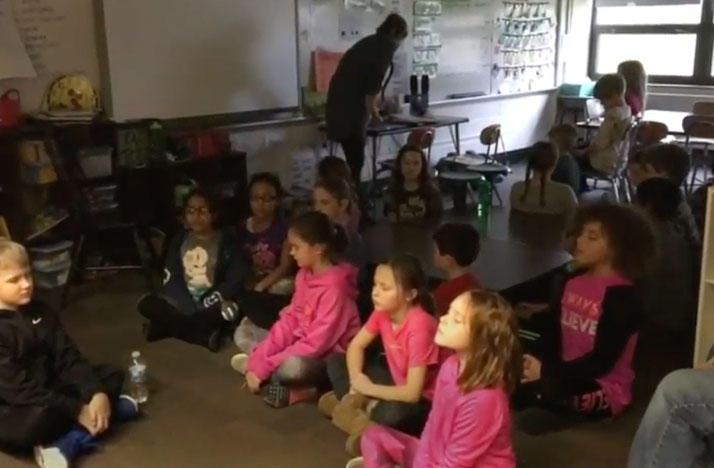 Students meditating