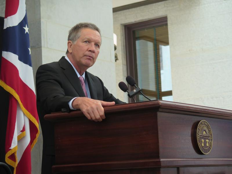 Gov. John Kasich speaking at a podium
