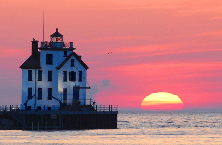The lighthouse on Lake Erie in Lorain, Ohio at sunset.