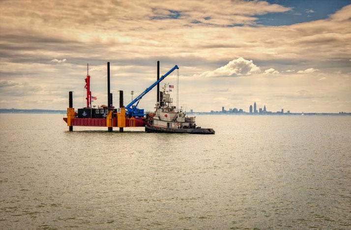 While some GOP lawmakers push to repeal Ohio's green-energy standards, one of the world's first fresh-water wind farms is taking shape in Lake Erie.