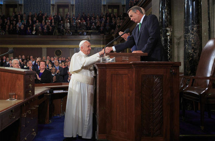 Pope Francis shakes hands with then Speaker of the House John Boehner during a speech before Congress in 2015.