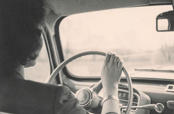 woman driving car - middle 20th century