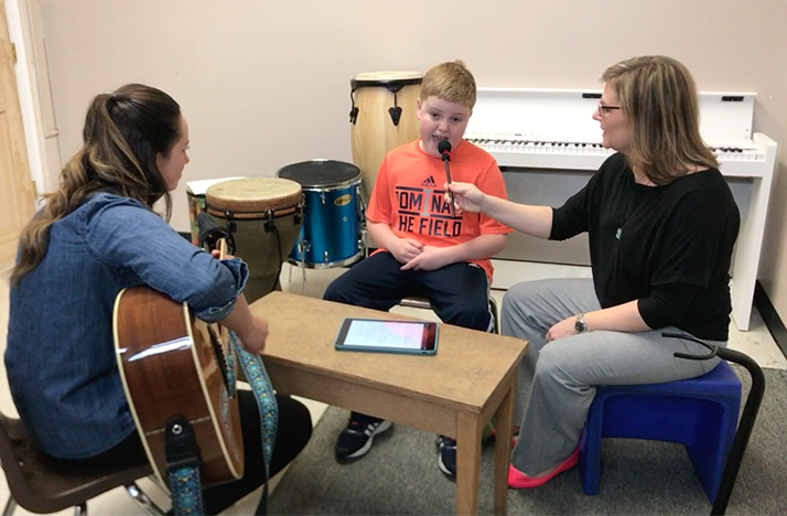 Brady, age 8, works on speech through song with music therapists Liz Woolley and Tanya Corso at Bridgeway Academy in Columbus.
