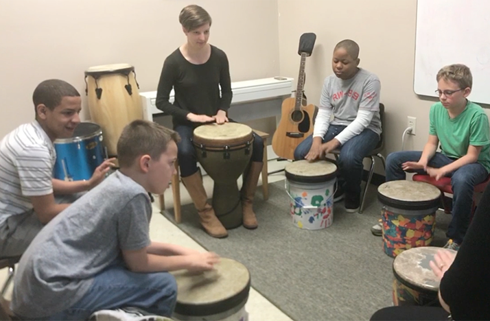 Music therapist Alyssa Graber leads a drum circle at Bridgeway Academy.