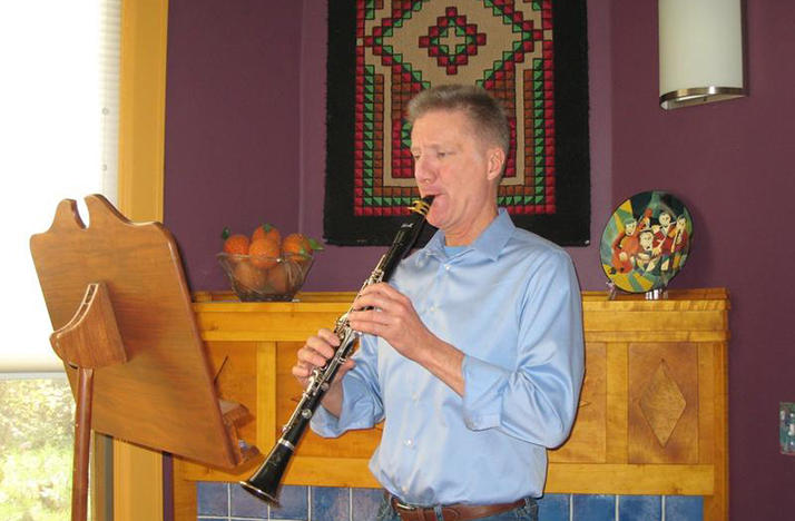 color photo of David Thomas playing his clarinet