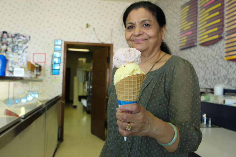 Mita Shah holds two scoops of her signature flavors, chikoo and kesar pista.