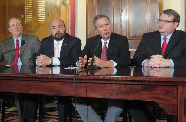 Ohio Budget Director Tim Keen (from left), House Speaker Cliff Rosenberger, Governor John Kasich and Senate President Larry Obhof discuss changes to the state budget.