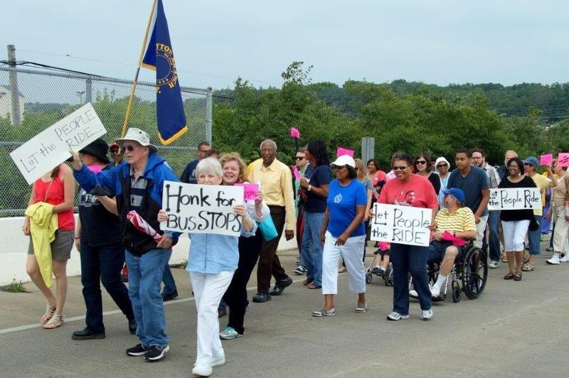 "A ""Human Bus"" rally crossed I-676 outside Dayton to protest for additional bus stops."