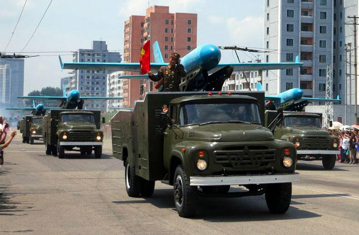 Military vehicles parade through Pyongyang for North Korea's Day of Victory celebration on July 27th 2013.