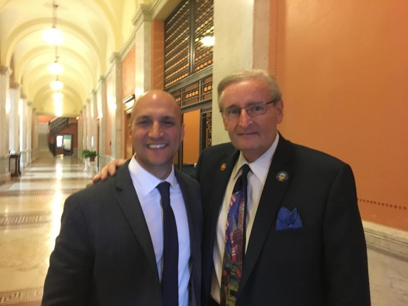 State Senator Joe Schiavoni, left, hands over the reins as minority leader to Kenny Yuko, right.