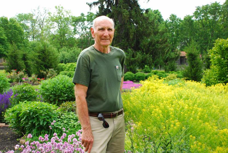 Scott Gordon, the mayor of Zoar Village, stands in the town's biblical garden.