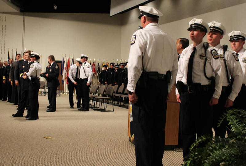 Graduates from the Columbus Police Academy last year accept their certificate from Chief Kim Jacobs and Mayor Andrew Ginther.