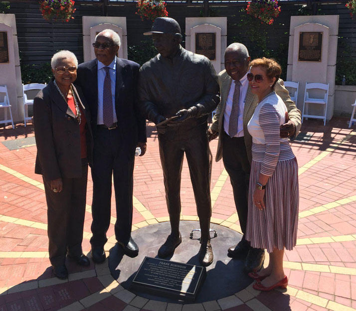 Frank Robinson stands to the left of his new statue in Heritage Park at Progressive Field. To the right is Robinson's friend, contemporary and fellow Hall of Famer, Hank Aaron.