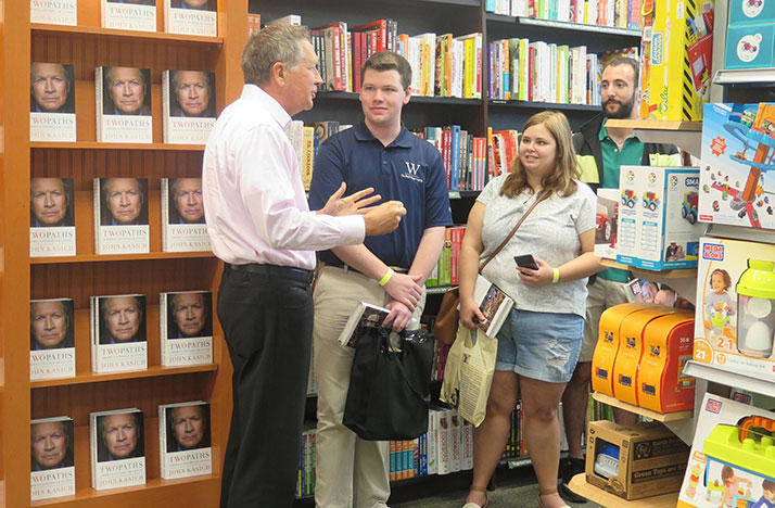 Gov. John Kasich speaks to Brent Lander, Rebecca Boruszewski and Steve Scimia - the first three people in line at his book signing in Westlake.
