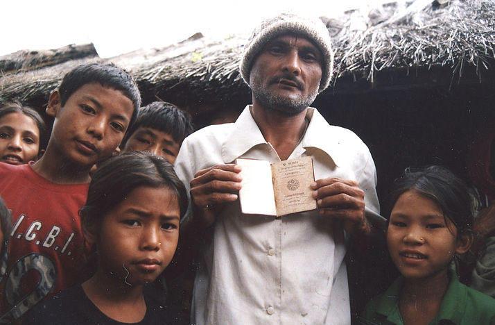 Bhutanese refugees in Beldangi I presenting a Bhutanese passport.