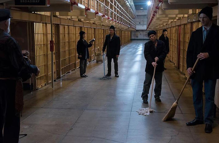 color photo of Vireo performers in Alcatraz cell block