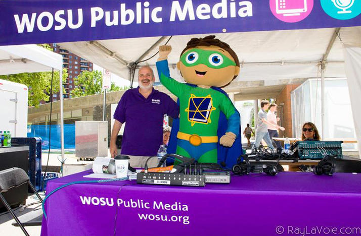 Christopher Purdy and costumed character at the WOSU booth at the Columbus Arts Festival
