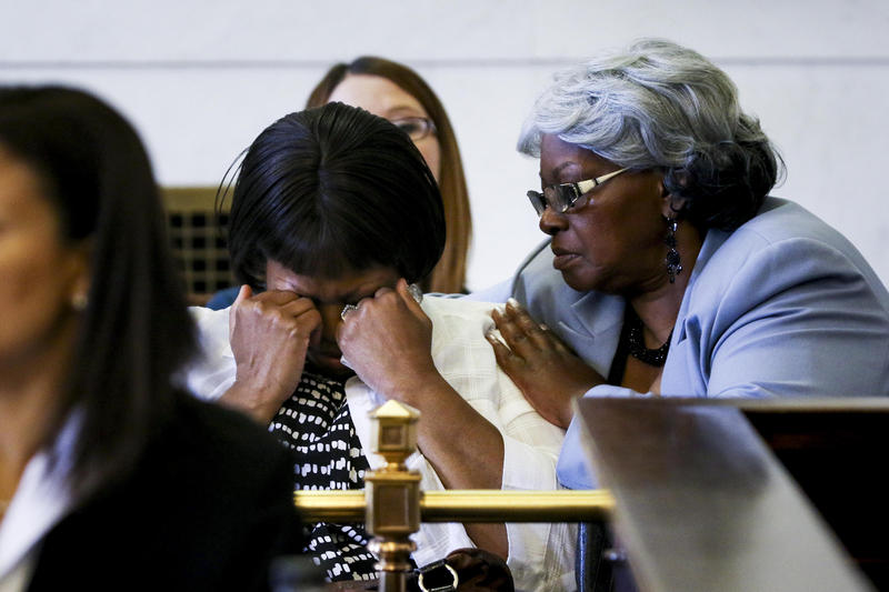 Terina Allen, Sam DuBose's sister, is comforted by her mother, Audrey DuBose, while listening to Ray Tensing testify.