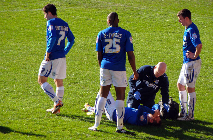 Athletic trainer tends to a injured soccer player