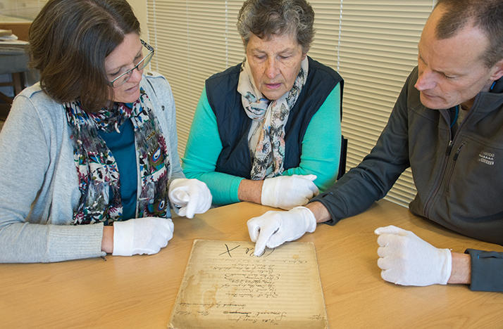 From left: Bay of Plenty Symphonia's Bronya Dean, librarian Gloria Pheasant and music director Justus Rozemond examine the score of 'Folk Songs from Somerset.'