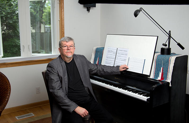 color photo of local composer Richard Jordan Smoot sitting at the piano