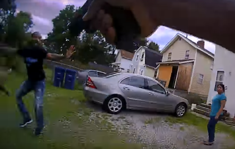 Video of the July 7 confrontation shows Jones with his hands in the air just before appearing to reach for a gun. His sister says she thinks he was trying to toss it.