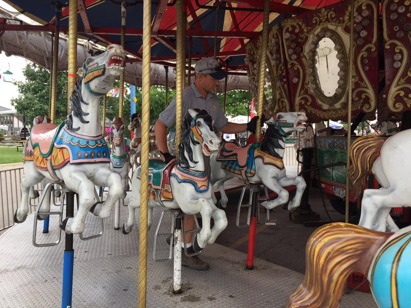 A ride inspectors with the Ohio Department of Agriculture looks at a carousel the morning after a ride malfunction that killed one man and injured seven other people.