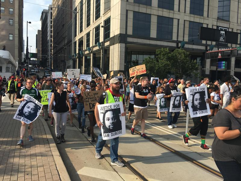 A crowd of people supporting Sam DuBose march through downtown Cincinnati on Saturday night demanding justice.