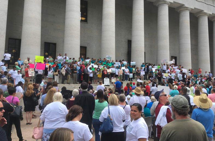 Rally at the Statehouse to save Medicaid expansion from proposed enrollment freeze.