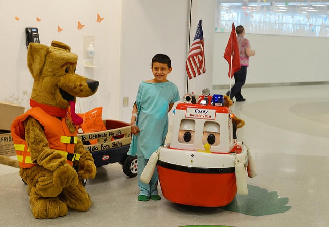 Patient poses with visitors at Nationwide Children's Hospital