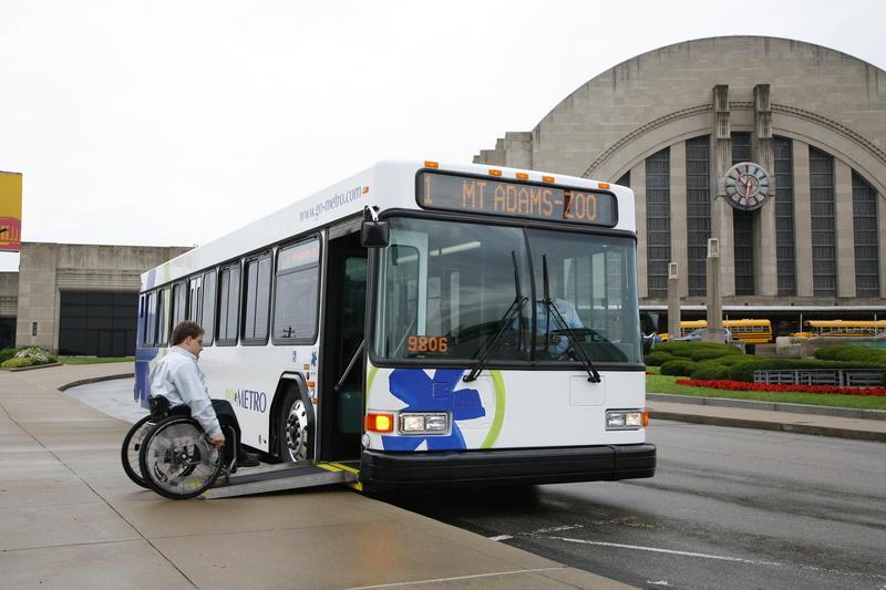 A man in a wheelchair gets onto a bus in Cincinnati.