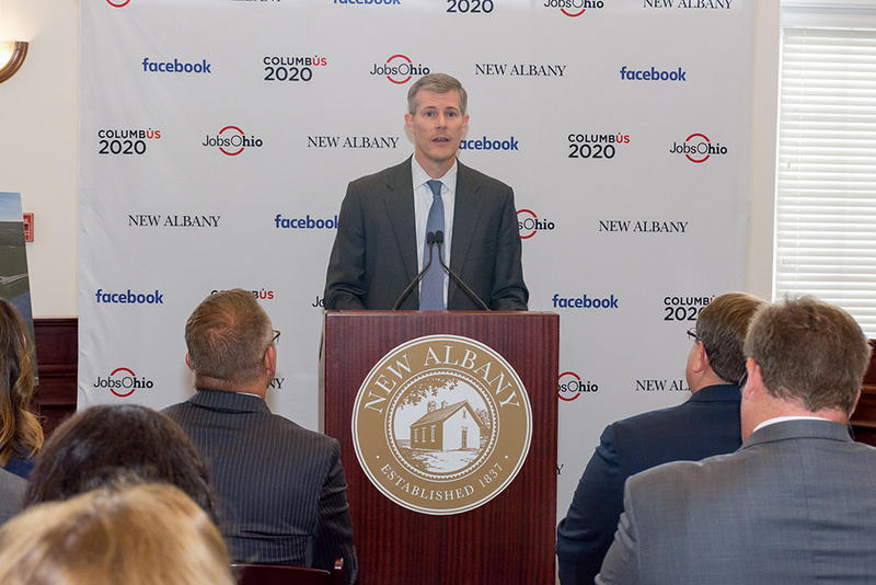 John Minor, president of JobsOhio, helps announce the building of a new Facebook data center in New Albany.