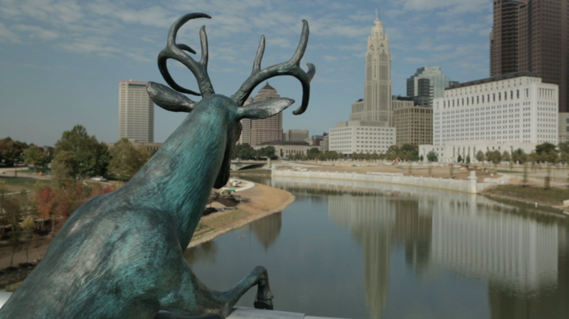 """Scioto Lounge"" involves three anthropomorphic deer that overlook the Scioto River in downtown Columbus."