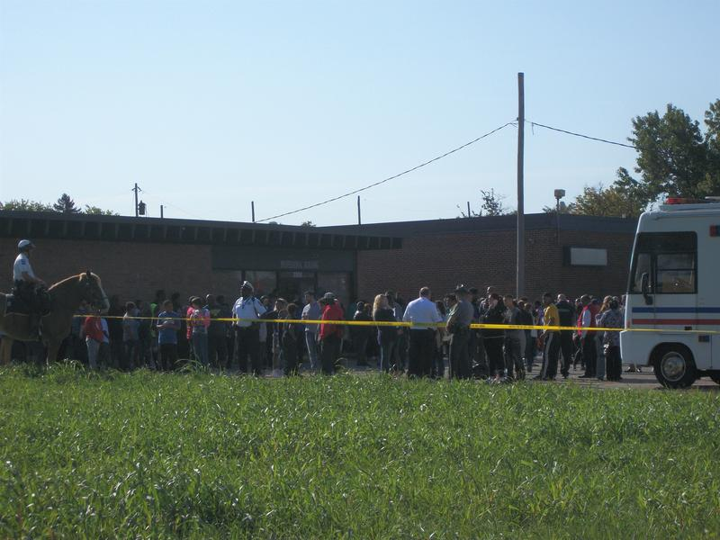 Students line up outside of Columbus-Scioto as Columbus Police investigate the building.